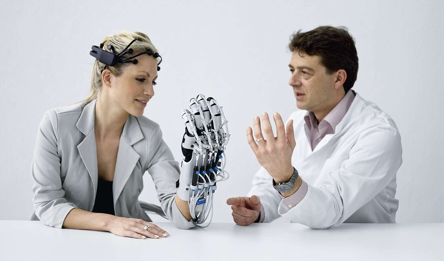Training the brain and muscles: ExoHand combined with a brain-computer interface