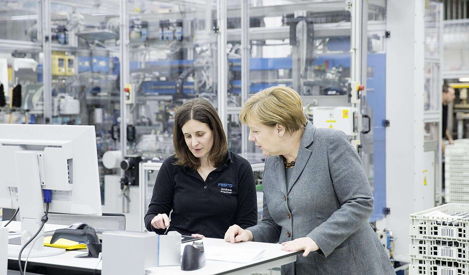 Angela Merkel visit Witnessing the production of tomorrow: German Chancellor, Dr Angela Merkel, visits the Technology