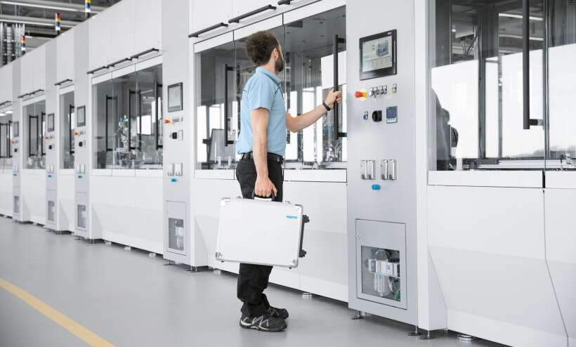 Industry 4.0 technologies: a worker inspects an assembly line
