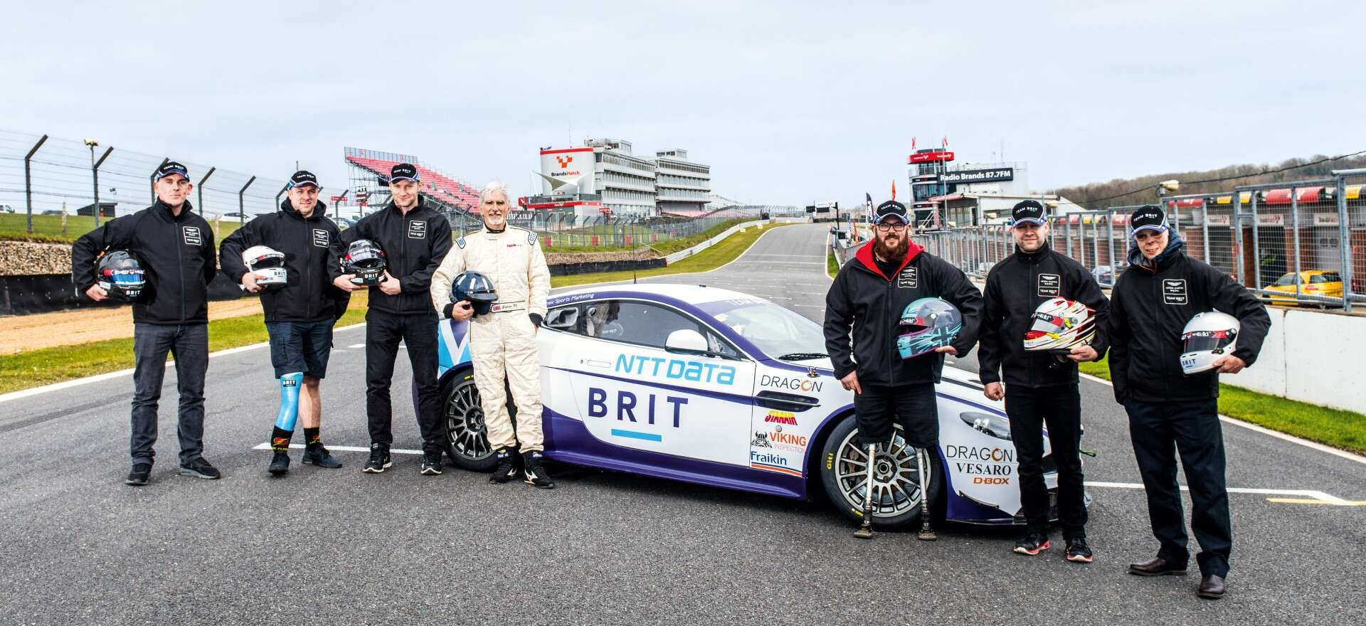 Team BRIT with sports car on the racetrack