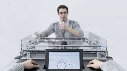 Festo CogniGame: Realization of the virtual game play on a real playing field with cognitive game control