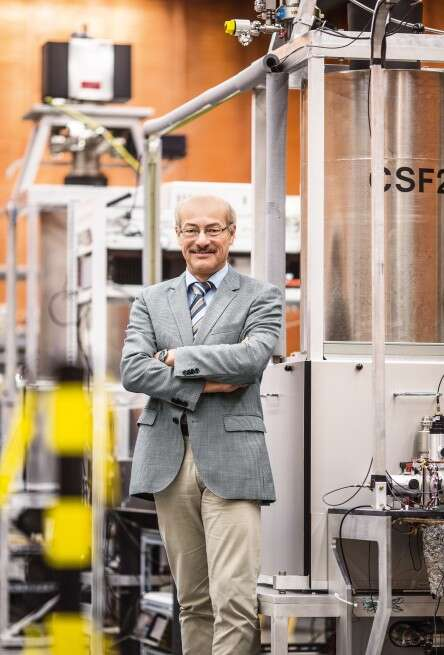 Prof. Dr. Joachim H. Ullrich and the two most accurate clocks of the PTB, the CSF1 and CSF2.