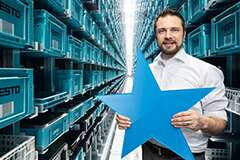 Employee in Festo warehouse with blue star in their hand
